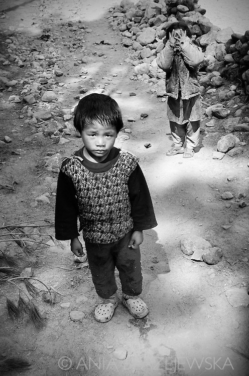 Nepal, Himalayas. Sherpa children on the road of a mountain village in the Everest region.