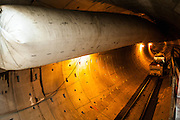 The East Side Big Pipe is a large sewer line and tunnel in Portland in the U.S. state of Oregon. It is part of a combined sewer system of pipes, sumps, drains, pumps, and other infrastructure that transports sewage and stormwater run-off to the city's Columbia Boulevard Wastewater Treatment Plant. The East Side Big Pipe project, begun in 2006 and finished in 2011, was the largest of a 20-year series of projects designed to nearly eliminate combined sewer overflows (CSO)s into the Willamette River and the Columbia Slough. The combined projects were completed on time, and they reduced CSOs into the river by 94 percent and into the slough by more than 99 percent. The East Side tunnel was the largest sewer construction project ever undertaken by the City of Portland. A contractor, Kiewit-Bilfinger Berger (KBB), used a tunnel-boring machine that was 300 feet (91 m) long and had a cutting head that was 25 feet (7.6 m) in diameter. In addition to the tunnel and the pipe, the project involved building seven access shafts, connecting pipelines, and the Portsmouth Forcemain, which carries sewage from the Swan Island Pump Station to the Columbia Boulevard Wastewater Treatment Plant.[3]<br /> <br /> The Portsmouth Forcemain, 3 miles (4.8 km) long and 66 inches (170 cm) in diameter, runs north from the pump station across Swan Island and under Waud Bluff and North Willamette Boulevard. There it meets the pre-existing Portsmouth Tunnel, which conveys combined sewage by gravity to the treatment plant.[4]<br /> <br /> Costs associated with the CSO projects, which totaled about $1.4 billion, included $450 million for the East Side CSO Tunnel and $70 million for the Portsmouth Forcemain. Most of the financing for the projects is coming from sewer ratepayers and almost none from state or Federal governments.The East Side tunnel was the largest sewer construction project ever undertaken by the City of Portland. A contractor, Kiewit-Bilfinger Berger (KBB), used a tunnel-boring machine that was 300 feet (91 m)