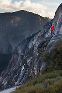 A hiker admires the view over Tenaya Canyon, Yosemite National Park