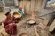 Women roast barley, which will be ground into flour for consumption, in the village of Nesang in Himachal Pradesh.