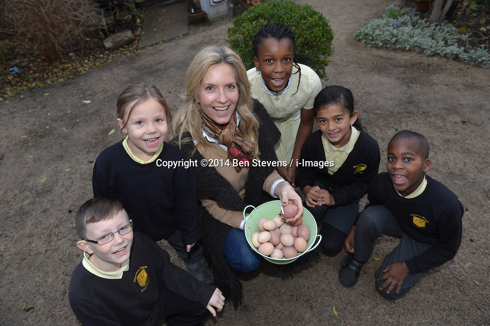 Image &copy;Licensed to i-Images Picture Agency. 18/12/2014. London, United Kingdom. <br /> <br /> Penny Lancaster visits Charlton Manor Primary School where the Mayors Fund initiative 'Penny for London' is raising money to fund breakfasts for school children.<br /> <br /> Penny Lancaster visits the school's chickens during breakfast club with students at Charlton Manor Primary School<br /> <br /> Picture by Ben Stevens / i-Images