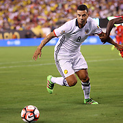 EAST RUTHERFORD, NEW JERSEY - JUNE 17: Edwin Cardona #8 of Colombia challenged by Christian Ramos #15 of Peru during the Colombia Vs Peru Quarterfinal match of the Copa America Centenario USA 2016 Tournament at MetLife Stadium on June 17, 2016 in East Rutherford, New Jersey. (Photo by Tim Clayton/Corbis via Getty Images)