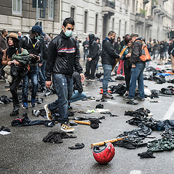 Foto Piero Cruciatti / LaPresse<br /> 01-05-2015 Milano, Italia<br /> Cronaca<br /> Manifestazione del 1 Maggio e proteste No Expo <br /> Nella Foto: Partecipanti alla manifestazione del 1 Maggio e gruppi antagonisti No Expo<br /> <br /> Photo Piero Cruciatti / LaPresse<br /> 01-05-2015 Milan, Italy<br /> News<br /> Mayday celebrations and No Expo protests <br /> In the Photo: People gather to celebrate Mayday and to protest against the opening of Expo 2015 No Expo and mayday protests in Milan turn violent.<br />