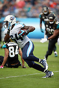 Tennessee Titans inside linebacker Avery Williamson (54) runs with the ball after recovering a fourth quarter strip and fumble during the NFL week 6 regular season football game against the Jacksonville Jaguars on Sunday, Oct. 12, 2014 in Nashville, Tenn. The Titans won the game 16-14. ©Paul Anthony Spinelli