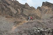 Visitors hike up Punta Pitt on San Cristobal island, part of the Galapagos islands of Ecuador.