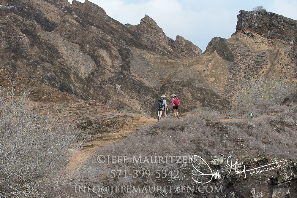 Visitors hike up Punta Pitt on San Cristobal island, part of the Galapagos islands of Ecuador.