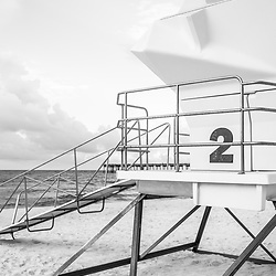 Lifeguard tower two Pensacola Beach Florida black and white photo. Pensacola Beach is on Santa Rosa Island in the Emerald Coast of the Southeastern United States of America. Photo is vertical and high resolution. Copyright ⓒ 2018 Paul Velgos with All Rights Reserved.