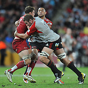 Scott Higginbotham is stopped in his tracks by the tackle of Luke Romano ~ Super 15 rugby (Round 15) - Reds v Crusaders played at Suncorp Stadium, Brisbane, Australia on Sunday 29th May 2011 ~ Photo : Steven Hight (AURA Images) / Photosport