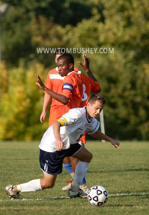 Middletown, N.Y. - An Orange County Community College player battles a Hostos Community College players for the ball during a men's soccer game on Oct. 6, 2007.