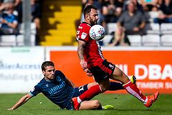 Luke Leahy of Bristol Rovers tackles Neal Eardley of Lincoln City - Mandatory by-line: Robbie Stephenson/JMP - 14/09/2019 - FOOTBALL - Sincil Bank Stadium - Lincoln, England - Lincoln City v Bristol Rovers - Sky Bet League One
