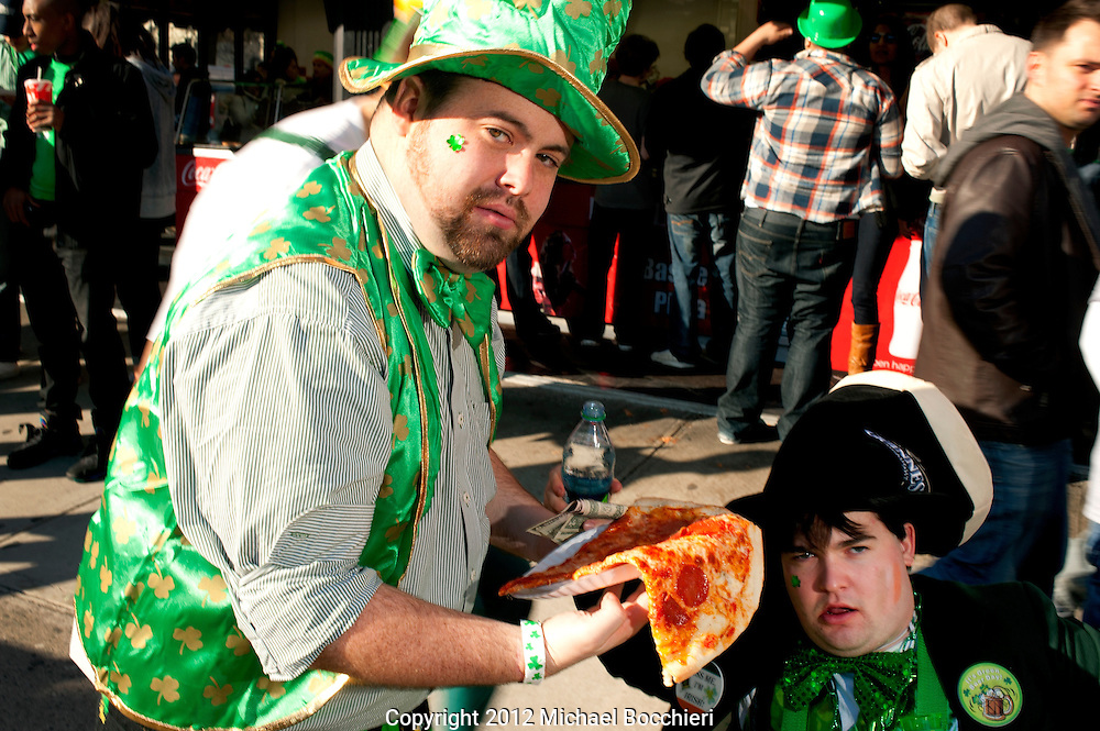 HOBOKEN, NJ - MARCH 03:  Two men eat pizza during the Lepre-Con event as part of St. Patrick's Day festivities March 03, 2012 in Hoboken, New Jersey. Following the city's cancelation of the annual St. Patrick's Day Parade organizers held a city-wide drinking event that attracted thousands to the area.  (Photo by Michael Bocchieri/Bocchieri Archive)