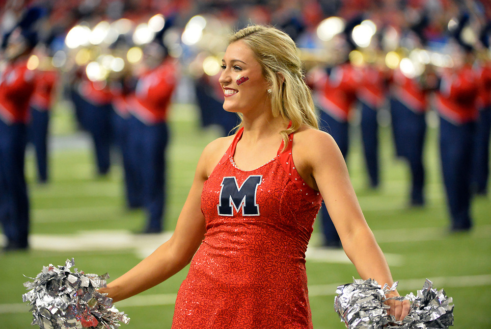Mississippi Rebels cheerleaders perform in the half of the Ole Miss vs. TCU Chick-fil-A Peach Bowl football game at the Georgia Dome on December 31, 2014. David Tulis / Abell Images for the Chick-fil-A Bowl