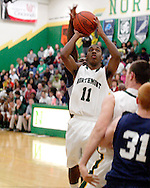 Northmont junior Keith Richardson (11) takes a shot in the first quarter as the Fairmont Firebirds play the Northmont Thunderbolts at Northmont High School in Clayton, Friday, December 16, 2011.