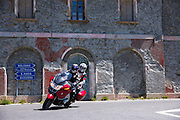 Motorcyclist and passenger on BMW Touring motorbike on The Stelvio Pass, Passo dello Stelvio, Stilfser Joch, to Bormio, Italy