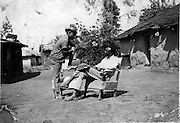 Nubian youth relax and talk at a traditional Nubian homestead in the Makongeni section of Kibera.  (circa 1950s)
