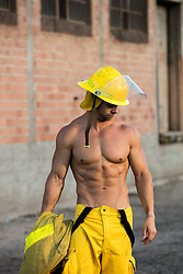 sexy muscular fireman without a shirt outdoors