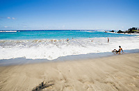 Tourists enjoying the surf at Hamoa Beach, Maui, Hawaii
