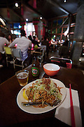 "Darling Harbour. Cockle Bay Wharf. ""Chinta Ria, Temple of Love"" Malay/Asian restaurant. Mee Goreng (noodles with meat) and VB beer (Victoria Bitter)."