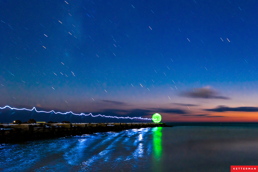 Dusk turns to night at Bradenton Beach and light orbs dance below the stars.