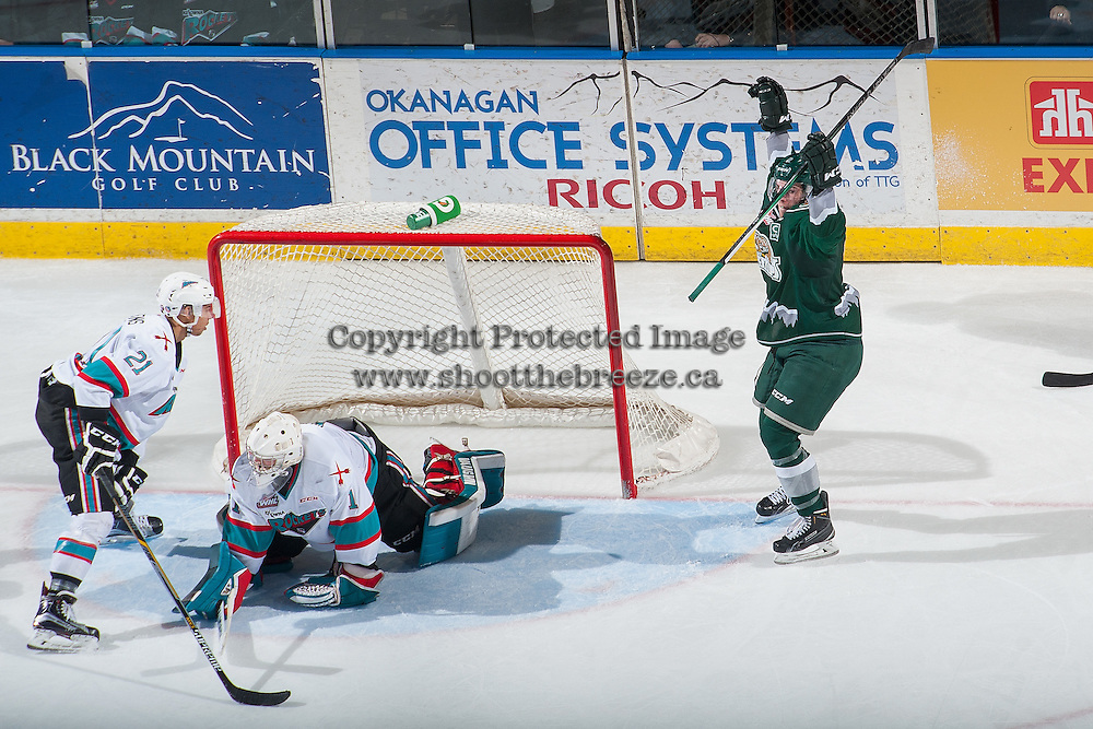 KELOWNA, CANADA - DECEMBER 30: Dawson Leedahl #12 of Everett Silvertips scores the winning goal in overtime on Jackson Whistle #1 of Kelowna Rockets on December 30, 2015 at Prospera Place in Kelowna, British Columbia, Canada.  (Photo by Marissa Baecker/Shoot the Breeze)  *** Local Caption *** Dawson Leedahl; Jackson Whistle;