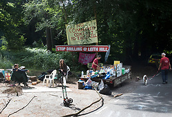 © Licensed to London News Pictures. 23/06/2017. Dorking, UK. The remaining environmental protestors have moved their camp over the road after being evicted. Workers are dismantling a protest fort built over an oil well site near Leith Hill in the North Downs . Protestors have been evicted from the camp over the last few days. Planning permission for 18 weeks of exploratory drilling was granted to Europa Oil and Gas in August 2015 after a four-year planning battle. The camp was set up by protestors in October 2016 in order to draw attention to plans to drill in this Area of Outstanding Natural Beauty (AONB) in the Surrey Hills. The camp has received support from the local community. Photo credit: Peter Macdiarmid/LNP