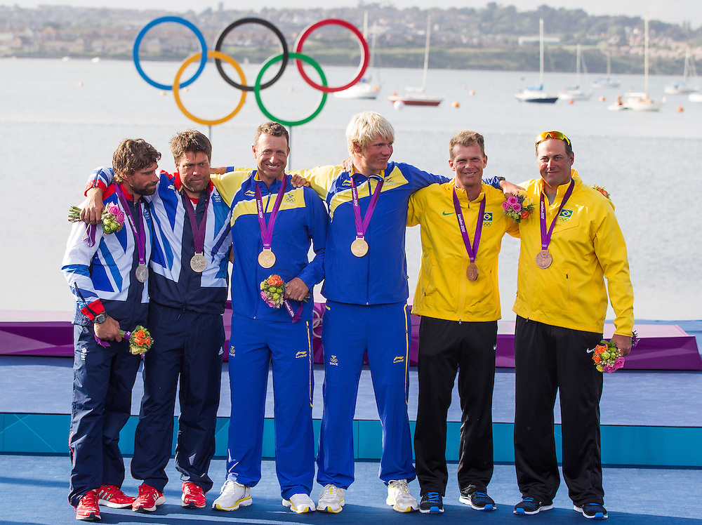 ENGLAND, Weymouth. 5th August 2012. Olympic Games. Star Class. Medal Ceremony. L-R. Iain Percy (GBR) Helm, Andrew Simpson (GBR) Crew, Siver medalists. Fredrik Loof (SWE) Helm, Max Salminen (SWE) Crew, Gold Medalists, Robert Scheidt (BRA) Helm, Bruno Prada (BRA) Crew, Bronze medalists.