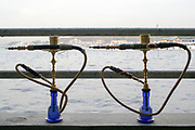 two middle eastern water pipes with the Bosphorus straits, Istanbul in the background