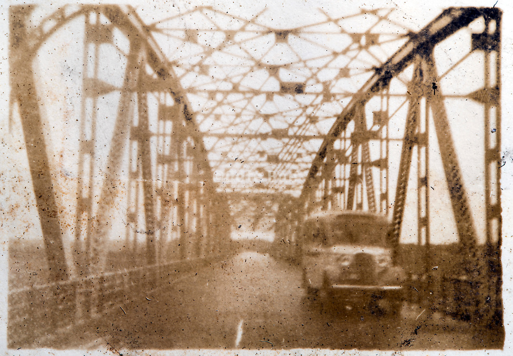 bus crossing a bridge Japan ca 1930s
