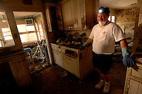 """The hurricane did pass and we were high and dry until the levy broke, when we proceeded to get 8 feet of water... We realized things were not going to be the way they were before.""  Guy Curry's home in Lakewood, LA was complete destroyed by the flood waters after the levy broke following hurricane Katrina two months ago."