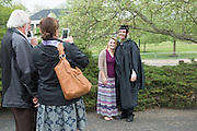 Tim Viola poses for a photo with Krisy Viola followeing graduate commencement, where Tim received his masters in education. Photo by Ben Siegel