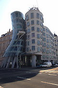 "The Dancing House (Czech: Tanc?ící du?m) is the nickname given to the Nationale-Nederlanden building in downtown Prague, Czech Republic at Ras?ínovo nábr?ez?í 80, 120 00 Praha 2. It was designed by Croatian-born Czech architect Vlado Milunic´ in co-operation with Canadian architect Frank Gehry on a vacant riverfront plot The very non-traditional design was controversial at the time. Czech president Václav Havel, who lived for decades next to the site, had supported it, hoping that the building would become a center of cultural activity...Originally named Fred and Ginger (after Fred Astaire and Ginger Rogers - the house vaguely resembles a pair of dancers) the house stands out among the Neo-Baroque, Neo-Gothic and Art Nouveau buildings for which Prague is famous. Others have nicknamed it ""Drunk House""."