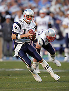 SAN DIEGO - JANUARY 14:  Quarterback Tom Brady #12 of the New England Patriots scrambles as he leads his team to a fourth quarter comeback win over the San Diego Chargers at the AFC Divisional Playoff Game held on January 14, 2007 at Qualcomm Stadium in San Diego, California. The Patriots defeated the Chargers 24-21. ©Paul Anthony Spinelli *** Local Caption *** Tom Brady