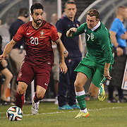 Rúben Amorim, (left), Portugal, is chased by Aiden McGeady, Ireland, during the Portugal V Ireland International Friendly match in preparation for the 2014 FIFA World Cup in Brazil. MetLife Stadium, Rutherford, New Jersey, USA. 10th June 2014. Photo Tim Clayton