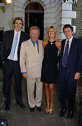 SIR DAVID & LADY CARINA FROST and two of their sons at Sir David & Lady Carina Frost's annual summer party held in Carlyle Square, London on 6th July 2004.