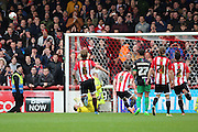 Bristol City goalkeeper, Richard O'Donnell (12) saving penalty from Brentford striker, Scott Hogan (9) during the Sky Bet Championship match between Brentford and Bristol City at Griffin Park, London, England on 16 April 2016. Photo by Matthew Redman.