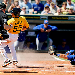 Mar 13, 2013; Bradenton, FL, USA; Toronto Blue Jays catcher Mike Nickeas (15) holds up his glove to home plate umpire Bill Welke after tagging out Pittsburgh Pirates catcher Russell Martin (55) at home to end the bottom of the third inning of a spring training game at McKechnie Field. Mandatory Credit: Derick E. Hingle-USA TODAY Sports