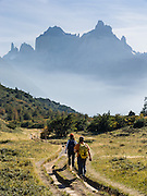 Trekkers walk towards Los Cuernos (the Horns) in Torres del Paine National Park, Chile, South America.