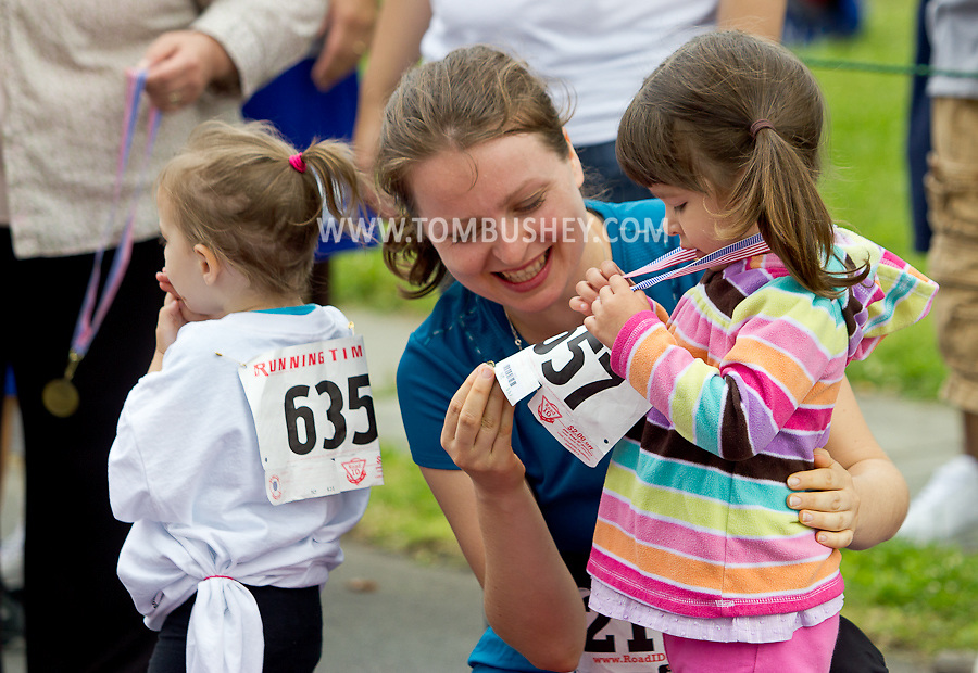 Middletown, New York - Children run in the Kids Dash at the 16th annual Ruthie Dino-Marshall 5K Run/Walk put on by the Middletown YMCA on Sunday, June 10, 2012.