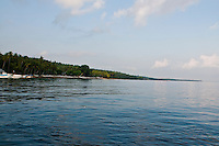 Boats along the coastline beach of Nusa Penida, Bali, Indonesia