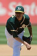 May 29, 2014; Oakland, CA, USA; Oakland Athletics starting pitcher Jesse Chavez (60) delivers a pitch during the third inning against the Detroit Tigers at O.co Coliseum. The Tigers defeated the Athletics 5-4.