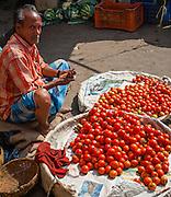 Tomato seller at street market (India)