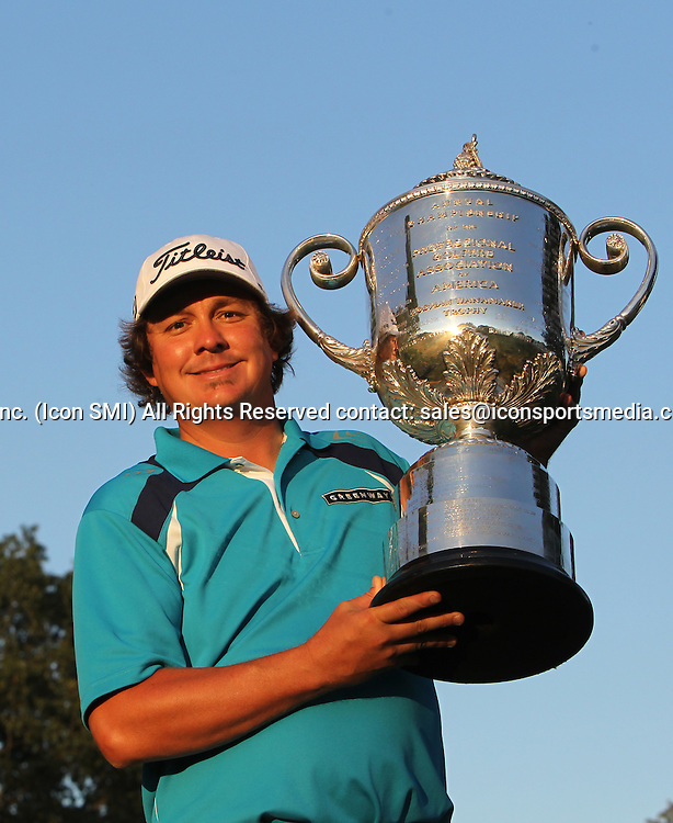 August 11 2013 Jason Dufner holds the Wanamaker trophy after winning the 95th PGA Championship during the final round at Oak Hill Country Club in Rochester, New York.