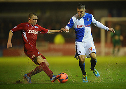 Bristol Rovers' Lee Brown is tackles by Crawley Town's Andy Drury - Photo mandatory by-line: Seb Daly/JMP - Tel: Mobile: 07966 386802 18/12/2013 - SPORT - FOOTBALL - Broadfield Stadium - Crawley - Crawley Town v Bristol Rovers - FA Cup - Replay