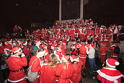 Trafalgar Square, London, December 12th 2015. SHigh spirits in Trafalgar Square as Santacon 2015 hits London. Every year in many cities around the world revellers dressed as Santa gather for pre-Christmas fun. ///FOR LICENCING CONTACT: paul@pauldaveycreative.co.uk TEL:+44 (0) 7966 016 296 or +44 (0) 20 8969 6875. ©2015 Paul R Davey. All rights reserved.