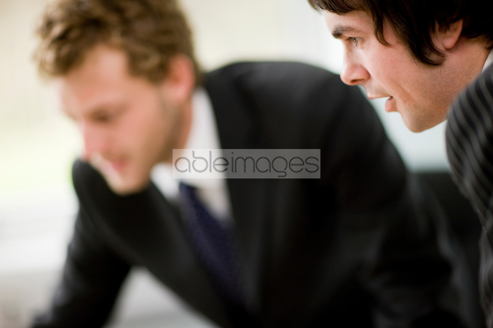 Close up of two young businessmen interacting