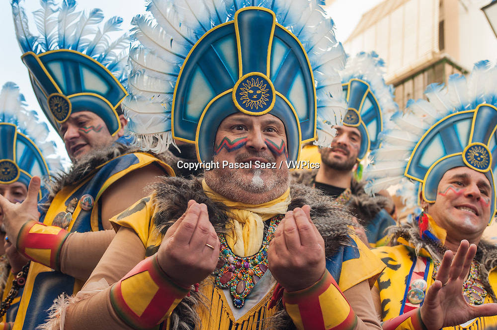 Feb.16, 2015 - C&aacute;diz, Spain - The C&aacute;diz carnival is underway. Carnival has a long tradition in the city of C&aacute;diz. The celebrations last 2 weeks each year in February.<br /> It is immensely popular among the city's residents, and even attracts visitors from all over Spain.<br /> C&aacute;diz's carnival is famous its &quot;Chirigotas&quot; and &quot;Comparsas&quot;, the choirs of local people who perform on streets and squares during carnival. Their repertoire of songs is varied and often has a witty satirical take on the years' political events and news, or humorous innuendo.<br /> In this image, a choir standing on a trailer towed by a tractor performs on a street corner, watched by a crowd of passers-by and revellers.