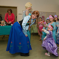 Charlotte Hawkins introduces Anna to her Memere during Anna and Elsa's Tea at the Gilford Community Center on Saturday morning.  (Karen Bobotas/for the Laconia Daily Sun)