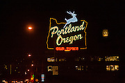 Portland Oregon neon sign at night while driving over Burnside Bridge