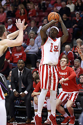 17 February 2018:  Milik Yarbrough hits a 3 while almost sitting on the bench during a College mens basketball game between the University of Northern Iowa Panthers and Illinois State Redbirds in Redbird Arena, Normal IL