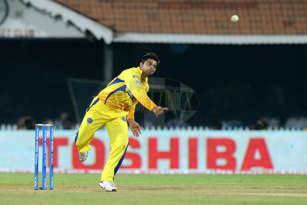 Suresh Raina of Chennai Super Kings bowls during match 3 of the NOKIA Champions League T20 ( CLT20 )between the Chennai Superkings and the Mumbai Indians held at the M. A. Chidambaram Stadium in Chennai , Tamil Nadu, India on the 24th September 2011..Photo by Pal Pillai/BCCI/SPORTZPICS
